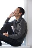Young man talking on mobile phone Stock Photos