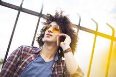 Young man talking mobile phone Stock Photos