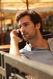 Young man talking on a mobile phone Stock Photos