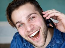 Young man talking on mobile phone Royalty Free Stock Photography