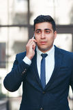 Young man talking on the mobile phone royalty free stock images