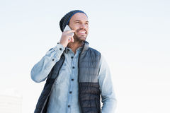 Young man talking on mobile phone. Happy young man talking on mobile phone on white background Stock Photos