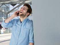 Young man talking on mobile phone and laughing Royalty Free Stock Photo