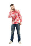 Young man talking on mobile phone looking away Royalty Free Stock Image