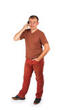 Young man talking on a mobile phone and smiling Stock Images