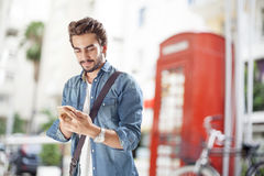 Young man talking mobile phone in street. Young handsome man talking mobile phone in street Royalty Free Stock Photo