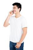 Young man talking on mobile phone Stock Images