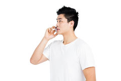 Young man talking on mobile phone Stock Photo