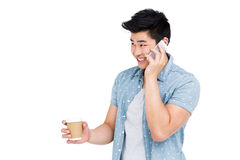 Young man talking on mobile phone Stock Image