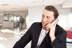 Young man talking at phone Royalty Free Stock Images