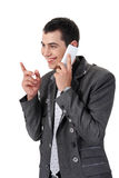 Young man talking on the phone Stock Images