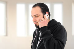 Young man talking on the phone. At home Royalty Free Stock Image