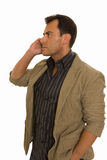 Young man talking on the phone. Isolated on white Royalty Free Stock Images