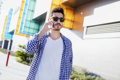 Young man talking phone in the city. Young man talking phone  in the city Stock Photography