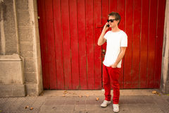 Young man talking on the phone in the city. Young urban man talking on the phone in the city Royalty Free Stock Image
