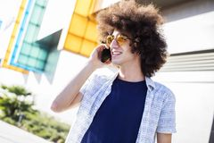 Young man talking phone in the city. Young man talking phone  in the city Royalty Free Stock Photo