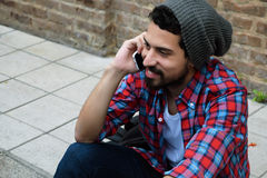 Young man talking on the phone. Stock Photos