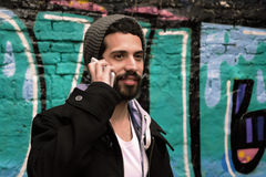 Young man talking on the phone. Stock Images