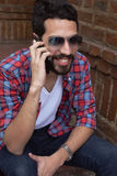 Young man talking on the phone. Stock Photo