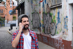 Young man talking on the phone. Royalty Free Stock Photography