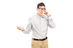 Young man talking on the phone Royalty Free Stock Image