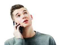 Young Man talking. On the phone and looking up Stock Photography