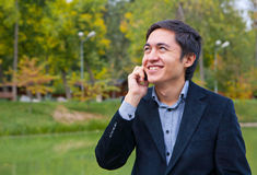 Young man talking on phone smiling Stock Images