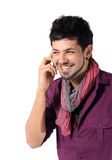 Young man talking on the phone on the white. Background stock photography