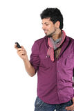 Young man talking on the phone on the white. Background Royalty Free Stock Photo