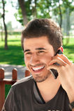 Young man talking on the smart phone Royalty Free Stock Photos
