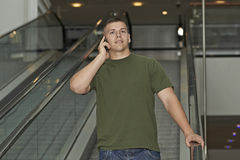 Young man talking on smartphone Royalty Free Stock Photography
