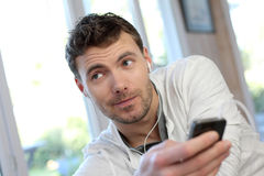 Young man talking on smartphone Royalty Free Stock Images
