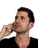 Young man is talking on the telephone. Young adult is talking on the telephone Stock Photo