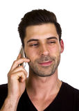 Young man is talking on the telephone. Young adult is happy while talking on the telephone Stock Images