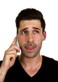 Young man is talking on the telephone. Young adult is happy while talking on the telephone Stock Photo