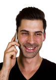 Young man is talking on the telephone. Young adult is happy while talking on the telephone Stock Image