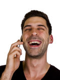 Young man is talking on the telephone. Young adult is happy while talking on the telephone Royalty Free Stock Photography