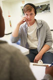 Young Man Talking To Counsellor Who Takes Notes Stock Image