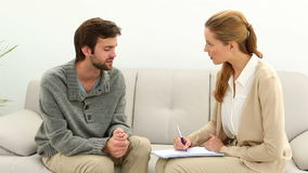 Young man talking to his therapist stock footage