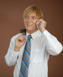 Young man talks by mobile phone. The young man talks by a mobile phone royalty free stock photography