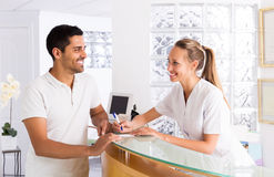 Young man talks with nurses Stock Images
