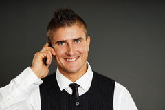 Young man talks with phone Stock Photography