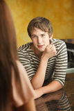 Young Man Talks to Woman Royalty Free Stock Images