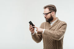 Young man tap on screen of his phone Royalty Free Stock Photo