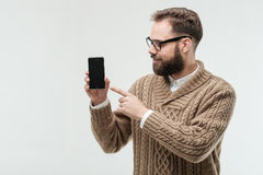 Young man tap on screen of his phone Stock Photo