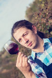 Young Man Tasting Wine Stock Photography