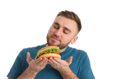Young man with tasty burger. On white background stock photo