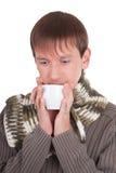 Young man with tea cup Stock Photos
