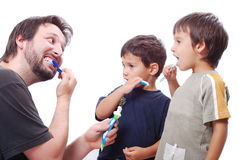 Young Man Teaching Kids How To Clean The Teeth Royalty Free Stock Photos