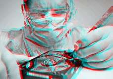 Anaglyph effect of man technician repairs hard disk. stock photo